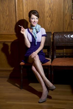 crossed cigarette: Attractive woman smoking a cigarette