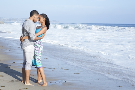 eachother: Young couple holding eachother on the beach