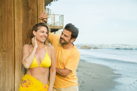 MIddle-age couple standing on the beach photo