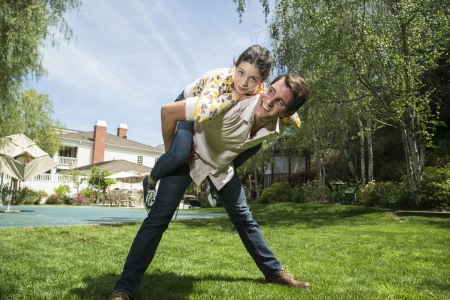 younger: Older brother and younger sister being playful Stock Photo