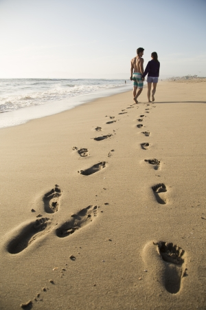 Footprints of young couple in the sand