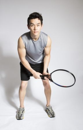 raquet: Athletic male holding tennis raquet Stock Photo