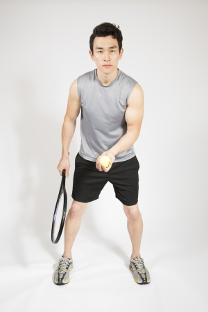 raquet: Athletic male holding tennis raquet and ball