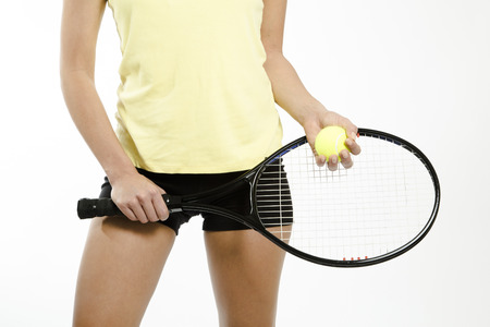 raquet: Female athlete holding tennis ball and raquet