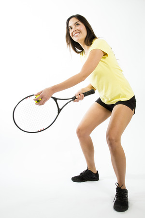 raquet: Young female athlete holding tennis ball and raquet