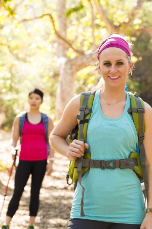 walking pole: Female hikers standing on trail