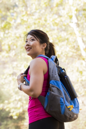 causcasian: Female hiker looking over her shoulder