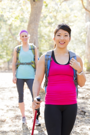 causcasian: Female hikers standing on trail