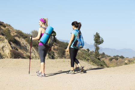 causcasian: Two female hikers on the trail
