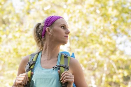 Female hiker looking over her shoulder