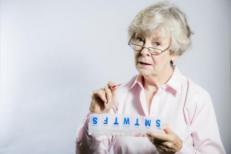 gramma: Elderly woman sorting her pillbox