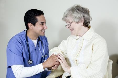 gramma: Male nurse assisting elderly patient Stock Photo