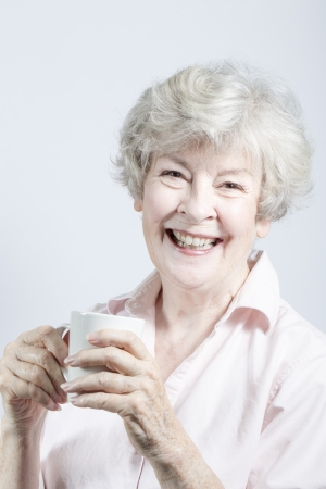 gramma: Elderly woman with coffee Stock Photo