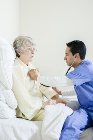 gramma: Male nurse listening to elderly woman