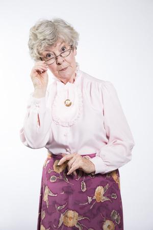 gramma: Stern elderly woman peering over glasses