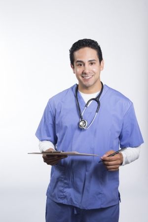 Smiling male nurse holding clipboard