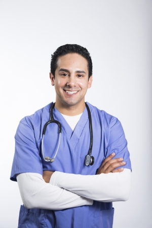 Smiling male nurse with arms crossed Stock Photo