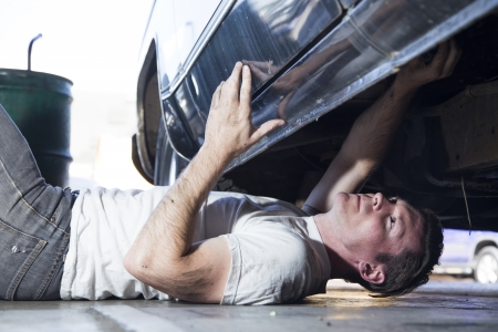 underneath: mechanic working on a car Stock Photo