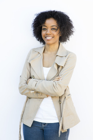 smiling african american woman against white background photo
