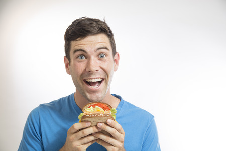 one eyed: man eating sandwich