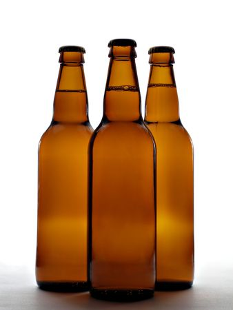 Three beer bottles isolated over white background photo