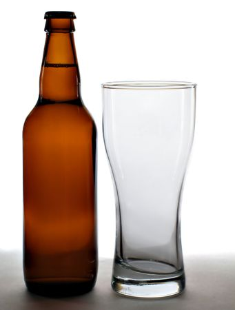 brew house: Bottle and empty glass isolated over a white background Stock Photo