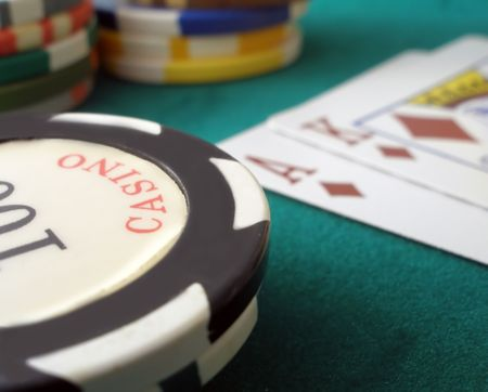 Casino chips and  ace king suietd