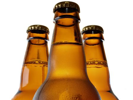 brew house: Upper part of three beer bottles isolated over white background