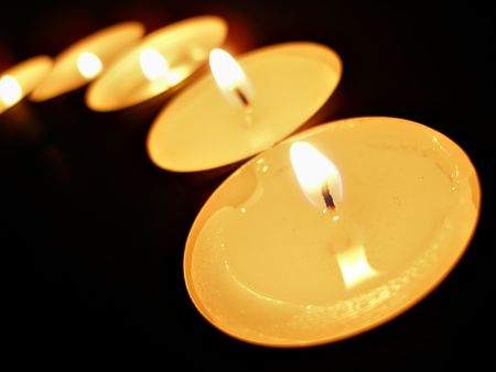 A row of candles over black background Stock Photo - 621483