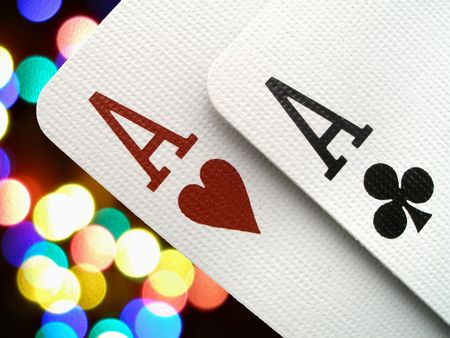 Two aces over colorful background photo