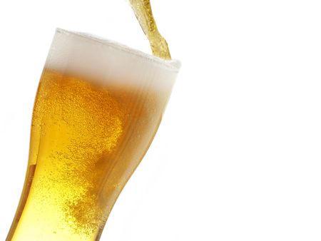 fill: Big mug fill with beer isolated over white background Stock Photo