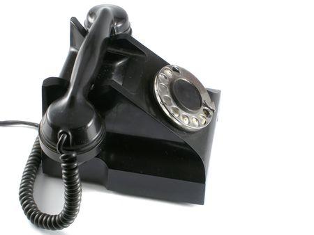 Old black phone over white background photo