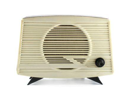 Old radio set over white background photo