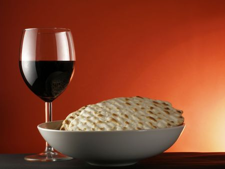 pesach: Wine and matzoh over red background Stock Photo