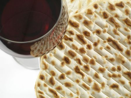 seder: Red wine and matzoh - tradition jewish passover bread close up