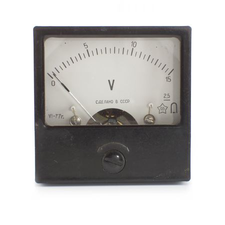 Old industrial voltmeter over white background. photo