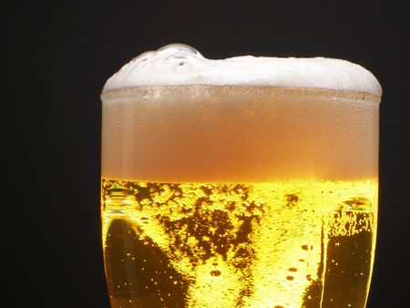 beerhouse: Beer within mug with foam over black background Stock Photo