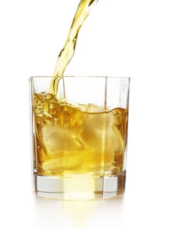 nightcap: Whiskey pour into the glass over white background