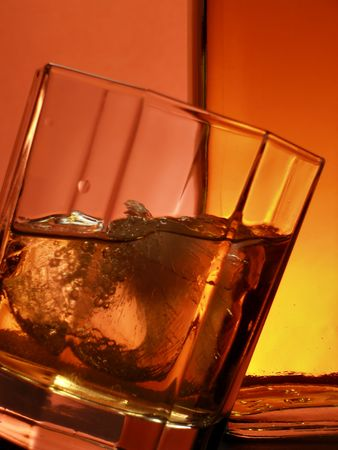 Glass of whiskey over red background Stock Photo - 747035