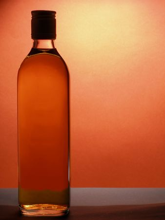 over packed: Packed whiskey bottle over red background with space for text
