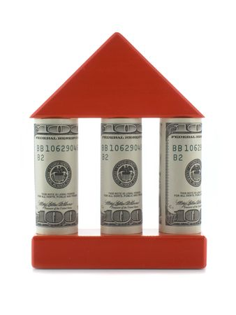 House with dollar bills as columns isolated over white background      photo