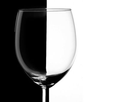 bocal: Transparent wineglass over contrast black and white background