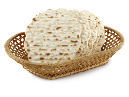 Matzoh - jewish passover bread within pottle over white background        photo