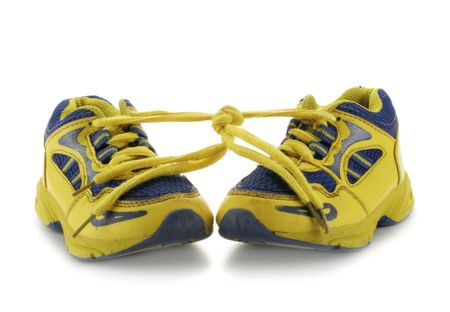 shoestring: Childs yellow running shoes isolated over a white background Stock Photo