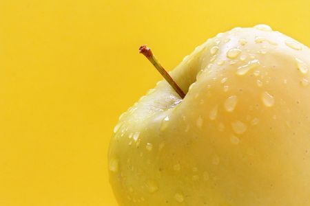 Granny smith apple isolated over yellow background Stock Photo - 875362