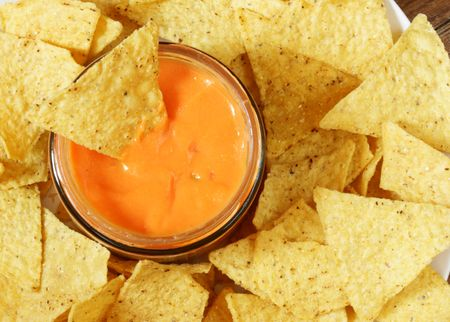 plateful: Nachos and cheese sauce close-up view from above Stock Photo