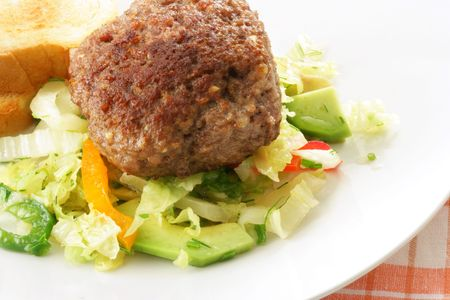Cutlet and fresh vegetable salad cllose-up photo