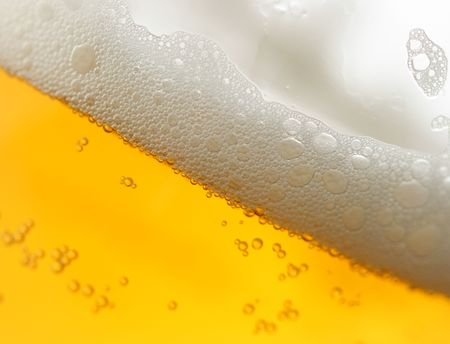 froth: Beer with froth within mug super close-up Stock Photo
