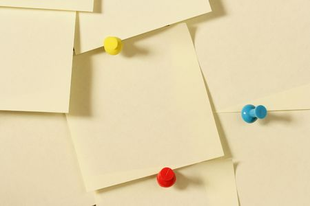 bulletinboard: Lots of blank notes attached to a wall Stock Photo