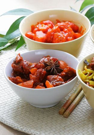plateful: Chinese dishes - beef with vegetables and pork with sour-sweet sauce